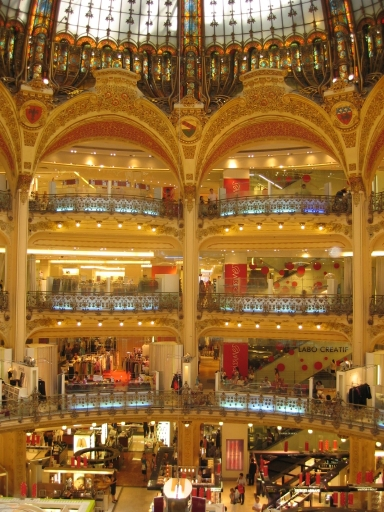Inside Galeries Lafayette look at the stained glass windows and architecture